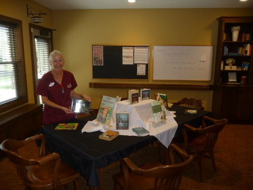 Patti shares her love of reading and her own personal library with the residents.