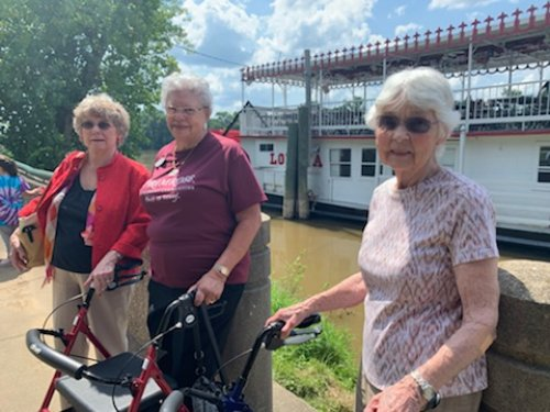 These ladies are ready to spend an afternoon on a boat ride.