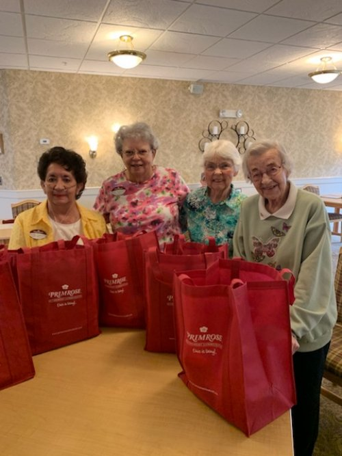 The Helping Hands Committee are ready to deliver the donated school supplies.