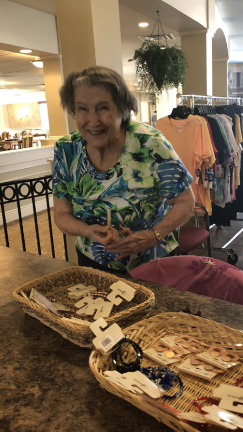 Thelma is trying to decide what earrings to purchase during a Bonworth Trunk Show.