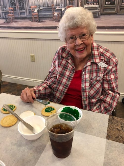 Resident Ambassador Shirley is taking a quick break from decorating cookies.
