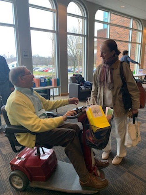 Ambassador Bob is talking to one of the visitor's during Random Acts of Kindness Day.