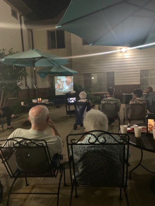 Residents watching Grease by the gazebo.
