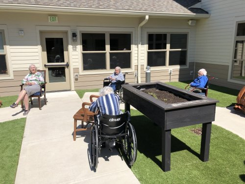 The residents love to Play word games in the great outdoors!