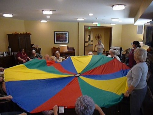 Working our arms with the parachute game
