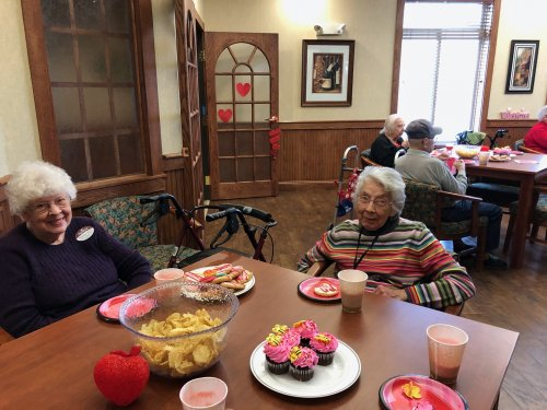 Shirley and Lola enjoying great company during Valentine's Day Party.
