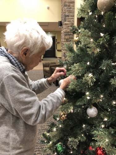 Ruth puts the finishing touches on our Christmas tree