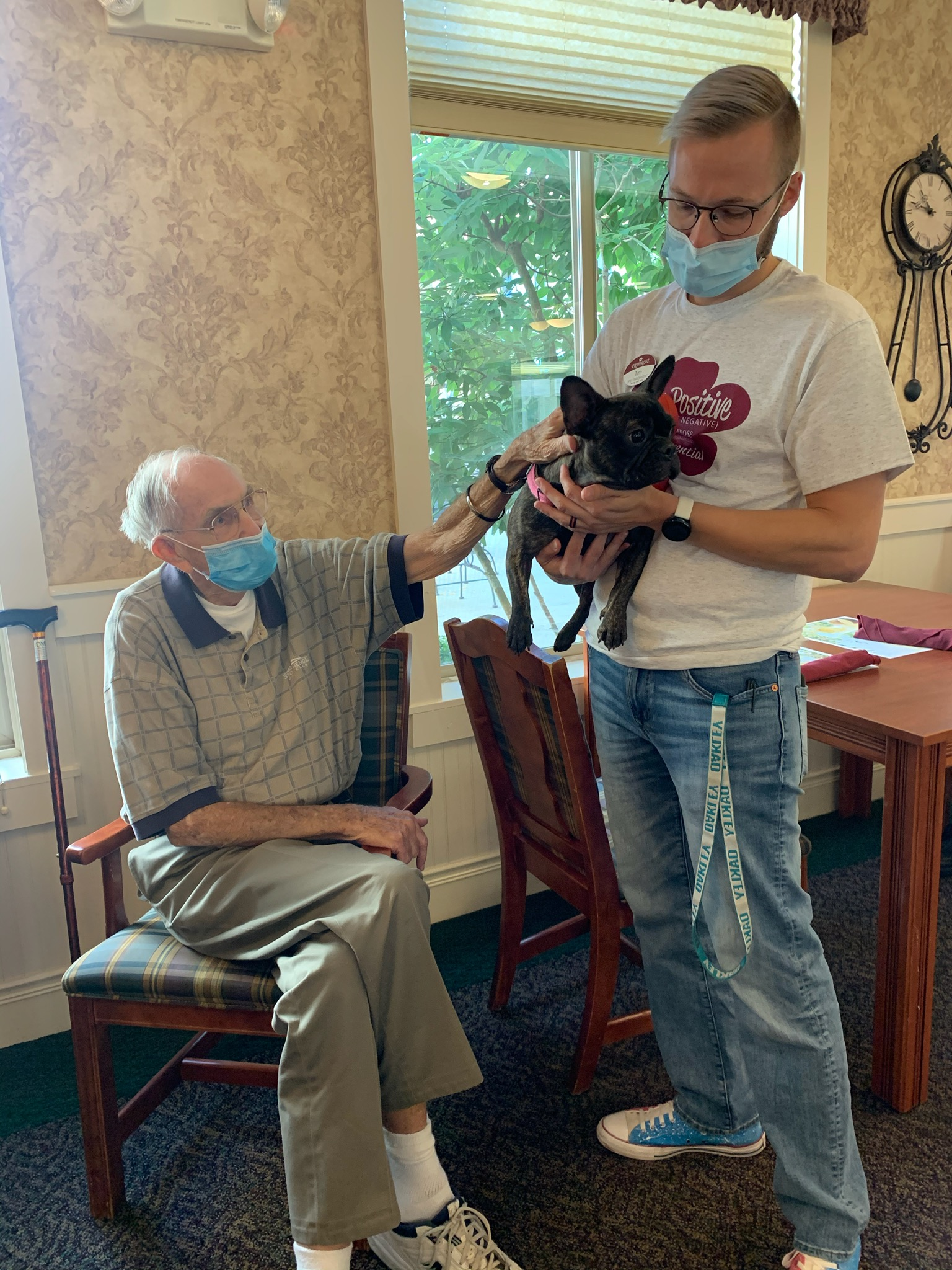 Memory Care LEC Tim brought Penelope in for a visit with Resident Bill.
