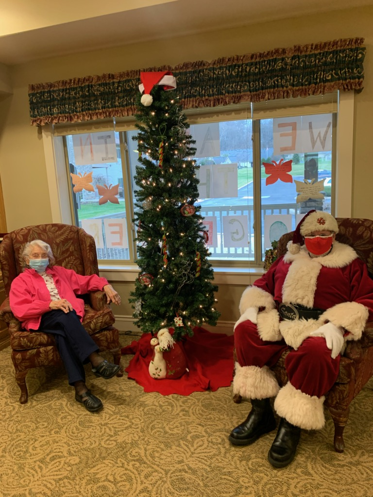 Having your picture taken with Santa is a little different this year. Lola and Carl the Cook are making the best of it.