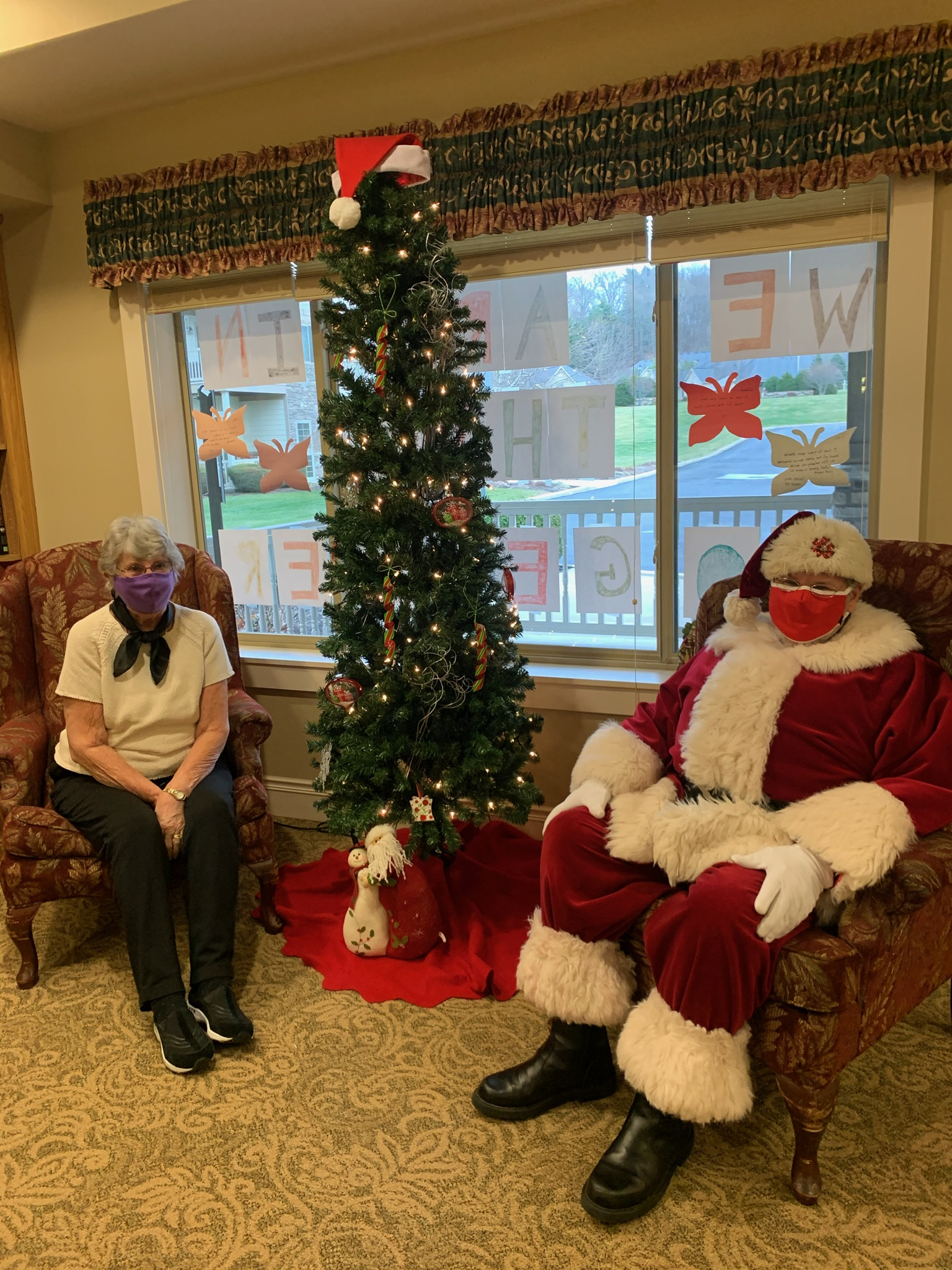 Having your picture taken with Santa is a little different this year. Lee and Carl the Cook are making the best of it.