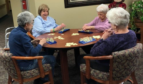 Tiz is learning how to play Rummicube with the professionals. Alberta, Anne and Marilyn