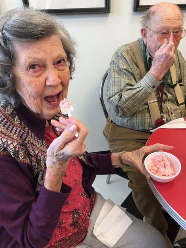 Mim and Larry are enjoying their ice cream on a Saturday afternoon.