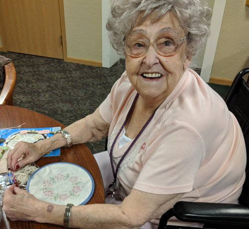 Rhea has quite the talents in crafting. Here she is doing embroidery. She also makes beautiful quilts.