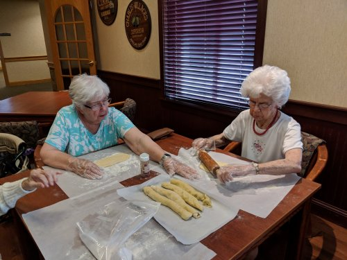 Ann & Audrey working together when rolling the cookie dough,that will be sliced and baked on July 4th.