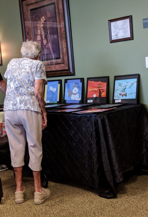 Mildred is looking for her paintings at the Art Show.