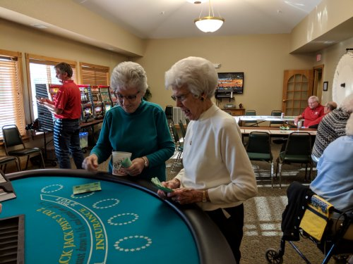 Audrey and Alberta trying their luck at Black Jack.