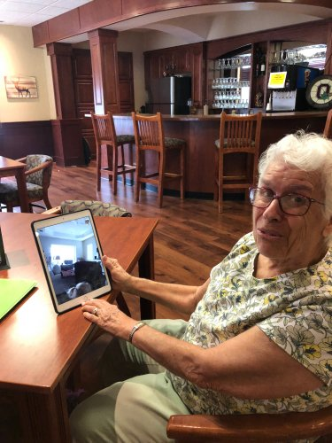 Lvera enjoys visiting with her family on Primrose's I Pad.