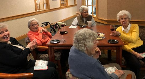 Jean, Mildred, Alberta, Audrey and Wilma are listening to the music of Don Smithey, enjoying a glass of wine and the tasty appetizers.