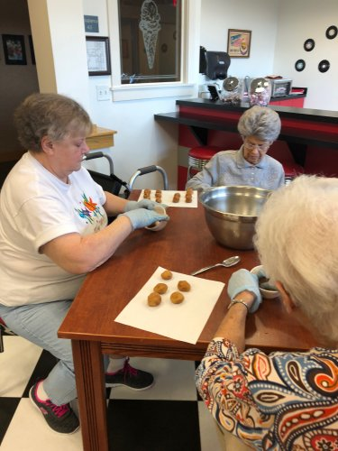 Rose, Rachel, and Lvera are making Snicker-doodle cookies in Baking & Sharing. They were a hit.