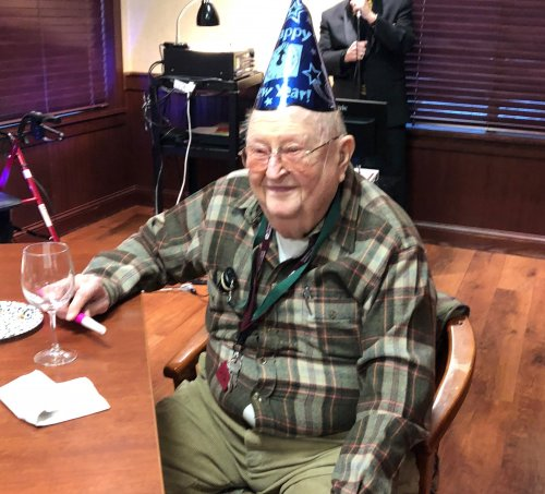 Larry H. is ringing in the New Year with Dick Valentine singing and A glass of wine.