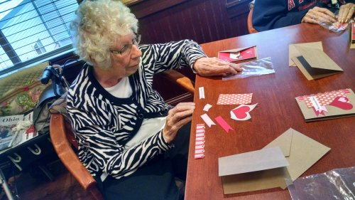 Betty making Valentine cards with Jayne from Awakening Minds.