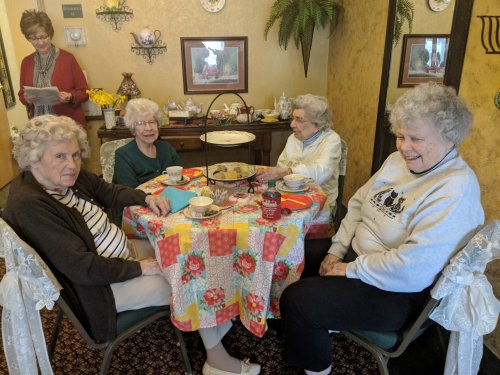 Wilma, Betty, Helen, and Kay are enjoying the teas and treats at the Spring Tea Party.