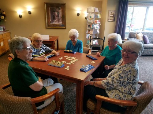 These ladies are enjoying a little friendly competition playing Rummicube.