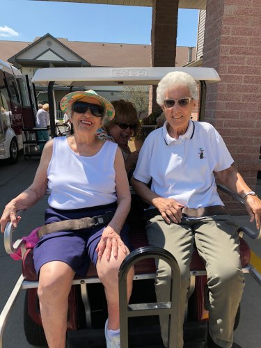 Pat and Alberta are going to hang on for dear life as they take a ride on the golf cart.
