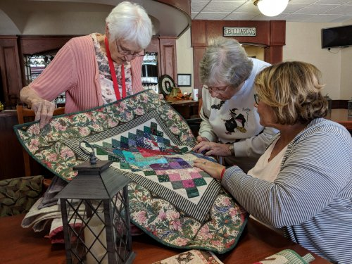 Mary sharing her quilts with other residents.They all were beautiful!