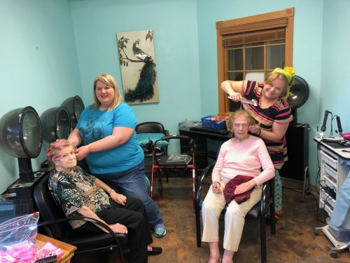 We are making the ladies happy. Washing and curling their hair. The SD and LEC were working together to make the ladies day.