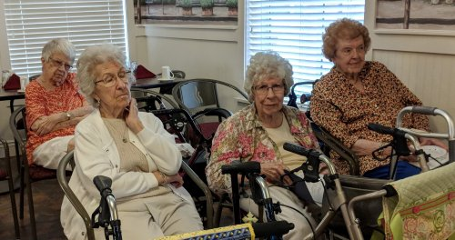 Betty S., Betty N.,, Marilyn K. and Leona B. enjoying a sing-a-long with Dan E. on the piano.