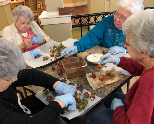 Wilma, Anne, Alberta, and Rose were dipping strawberries in chocolate for Valentine's Day