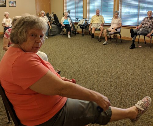 Betty and some of the other residents exercising with Kathy on this beautiful Tuesday morning.