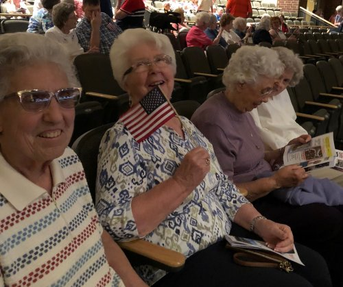 These ladies enjoyed an evening of patriotic songs.