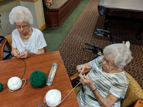 Audrey and Mildred trying their hand at crocheting.