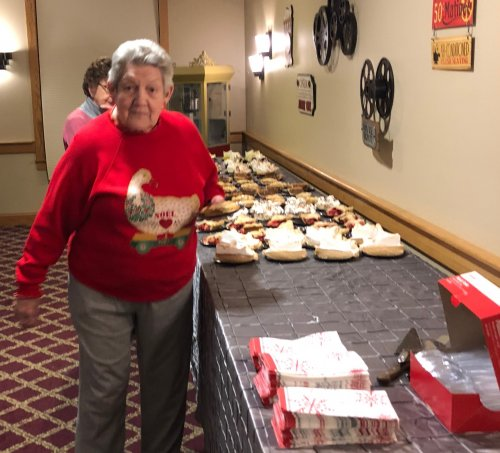 Carol Picking out her favorite Pie At The Christmas Open House