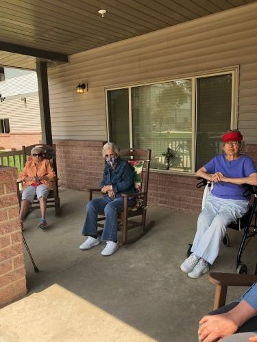 Social distancing out on the front porch. Marilyn, Alberta and Pat.