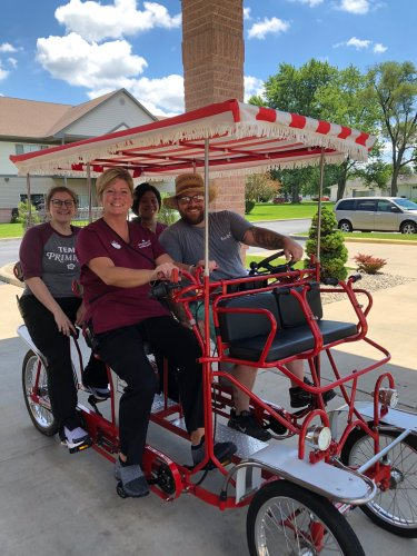 The staff at Primrose of Lima took a minute out of their busy day to take ride.