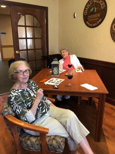 Shirley and Jean enjoyed caching up with each other during Happy Hour.