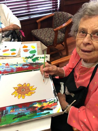 Betty V. is a budding artist, doing her painting with Awakening Minds Art.
