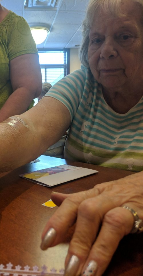 Betty working on a greeting card in scrapbooking class.