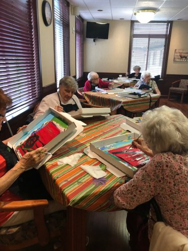 This group of ladies are busy painting with Awaken Minds Instructor!