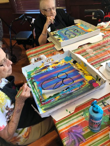 Betty and Betty enjoy painting with Awakening Minds.