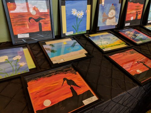 Art Show in the library, these paintings were done by residents at Awakening Minds Art class.