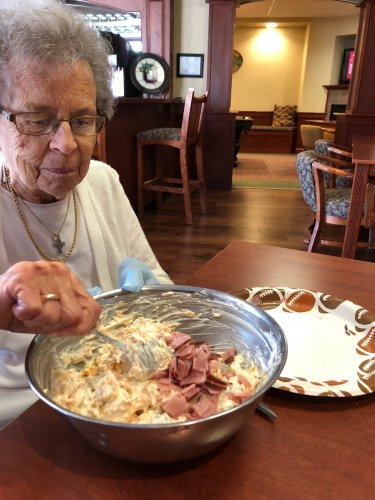 Betty is mixing up appetizers for Happy Hour.
