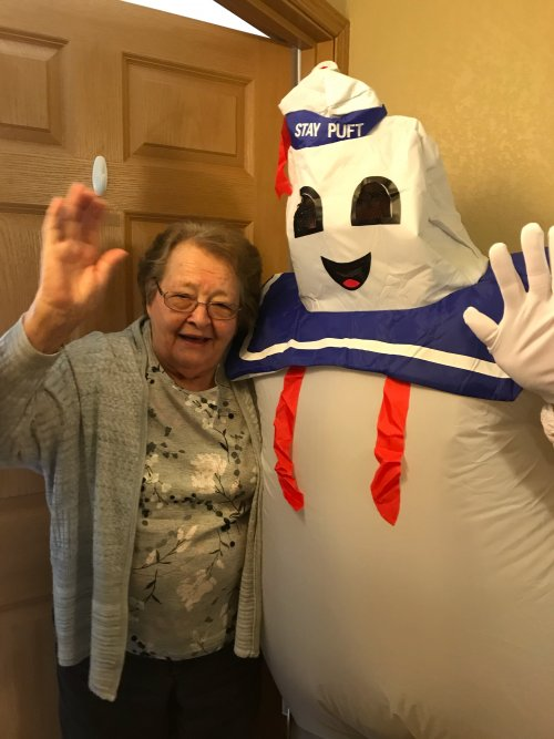 Edith and Marshmallow Man met in the hall. She was not afraid of him.