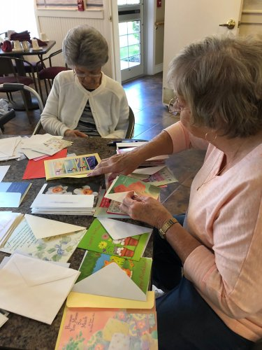 Rose, Betty, Rachel, and Rhea helped sort out greeting cards that had been donated. They also got a few ready to send out.