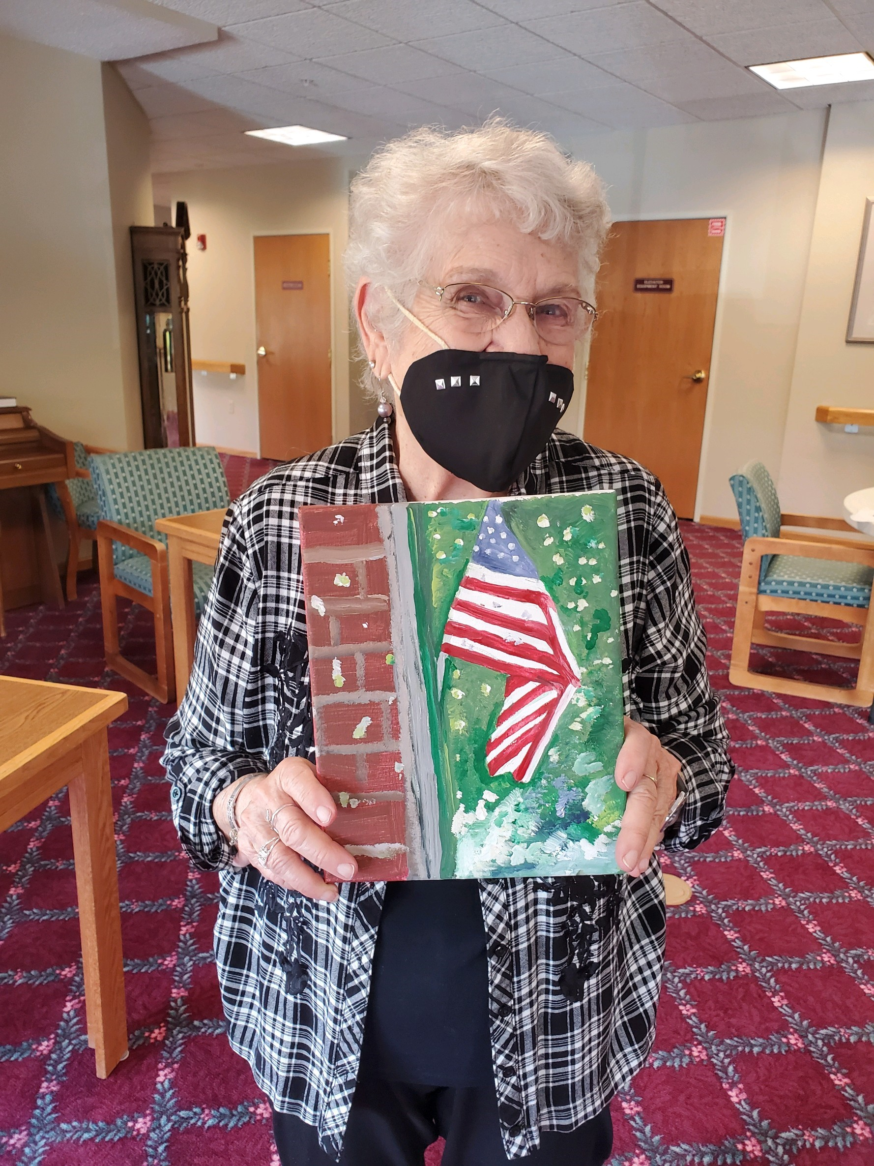 Norma is flashing her patriotic smile under that mask!