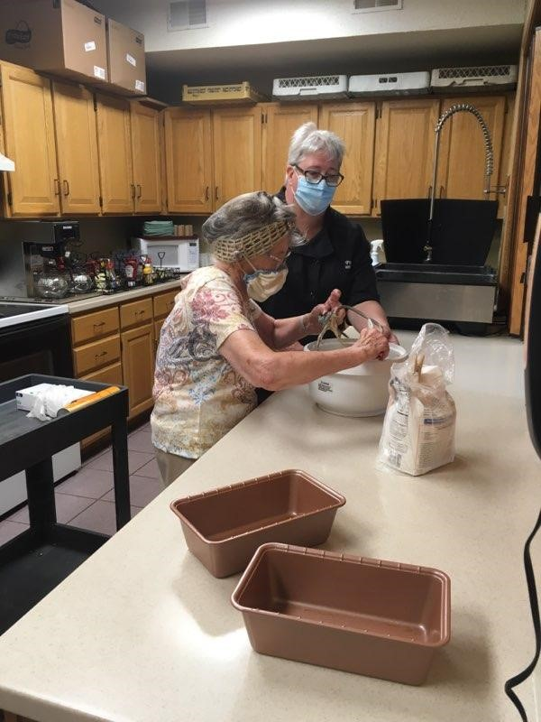 Lora, our Director of Dining, makes bread with Francie!