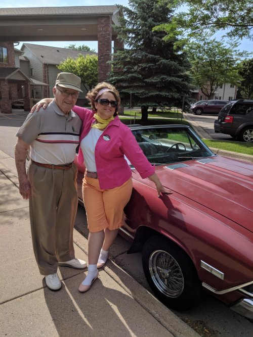 Don O. and Sales Director Lora B. celebrate the 50s and oggle at the '68 Chevelle owned by maintenance tech, Rick.
